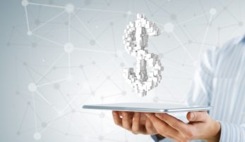 Hand of businessman showing tablet pc with dollar currency sign